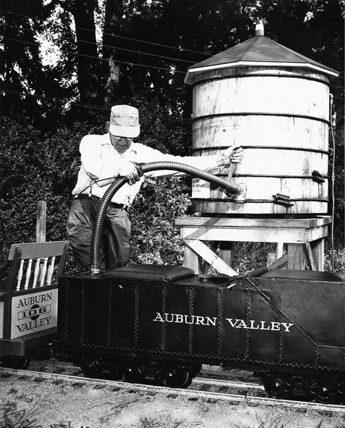 Clarence Marshall filling #401 tender at water tower