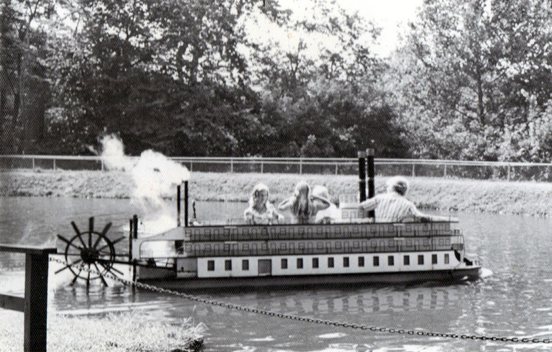 Paddle-wheel steamboat on pond