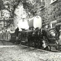 0-TCM-with-a-train-load-of-happy-youngsters-crosses-the-turntable-on-his-miniature-Auburn-Valley-R.R.,-early-Fall,-1960-adj.jpg